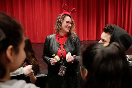 English Learner Instructional Coach Marisol Evans greets her students after being presented with a Golden Apple award at Washington Middle School on Thursday.