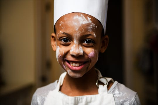 Myleigh McDowell, 8, poses for a portrait on Thursday, Feb. 14, 2019. McDowell is one three young chefs that will be participating in the upcoming CHOP! Cancer cook-off.