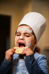 Jack Williams, 4, takes a bite out of a cookie during a portrait shoot on Thursday, Feb. 14, 2019. Williams is one three young chefs that will be participating in the upcoming CHOP! Cancer cook-off.