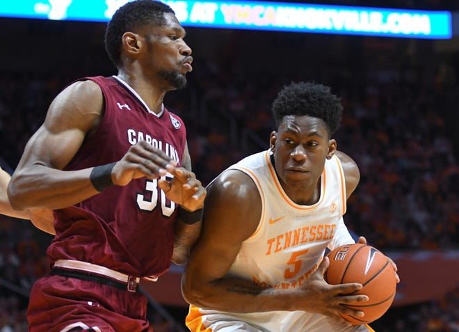 Tennessee guard Admiral Schofield (5) moves the ball against South Carolina forward Chris Silva (30) Wednesday night during the second half at Thompson-Boling Arena in Knoxville, Tenn.