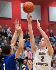 Wade Hampton's Nick Brenegan (2) shoots a basket over Riverside's Carl Kahaleh (3) at Wade Hampton High School Wednesday, Feb. 13, 2019.