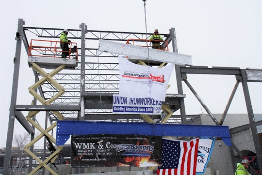 "The final beams being raised at Great Falls High's ""Topping Out"" ceremony"
