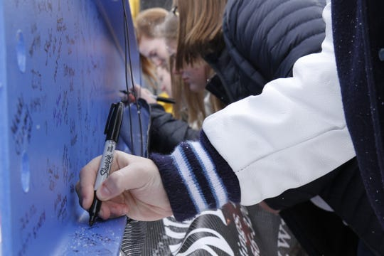 """GFH students attended the """"Topping Out"""" ceremony to leave their mark on the school for years to come."""