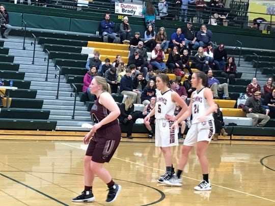 Sisters Janessa Willekes (No. 5, left in white) and Lissy Willekes (24) stand side-by-side during a Dutton-Brady free throw Wednesday afternoon at CMR Fieldhouse.