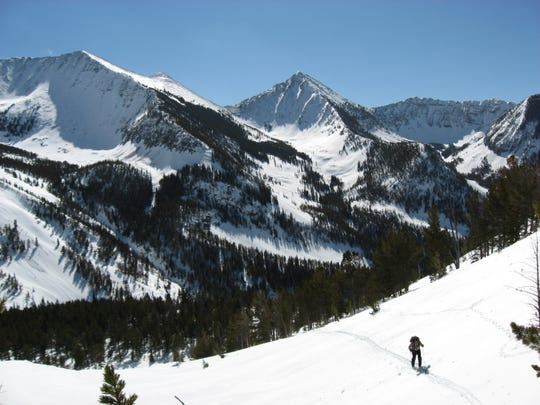 A skier in the Crazy Mountains, a beautiful landscape where access disputes have long simmered.