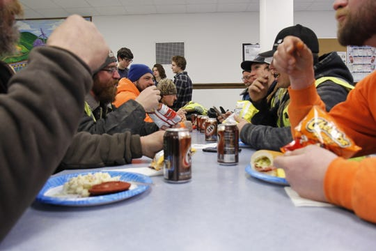 The construction workers were treated to root beer, sandwiches and other goodies for their work.