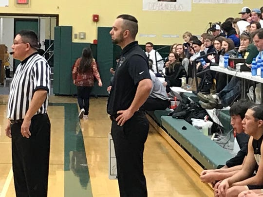 Heart Butte Warriors' head basketball coach Kellen Hall looks out at his team in the waning moments of his team's 54-28 win over Dutton-Brady at the District 10C Tournament at CMR Wednesday evening.