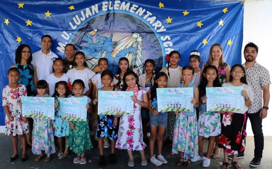M. U. Lujan Elementary School's fifth grade student council and grade levels took the Håfa Adai Pledge on Feb. 11 on behalf of the entire student body, who were in attendance. Representatives from the Guam Visitors Bureau administered the pledge event that kicked off the school's preparation for Chamorro Month. Back row from left: GVB Culture and Heritage Officer, Dee Hernandez; GVB Public Information Officer, Josh Tyquiengco; M. U. Lujan Elem. School Vice Principal Elias Taisapic; representatives of the student body; M. U. Lujan Elem. School Principal Natasha Dela Cruz; and GVB Acting Director of Tourism Research, Nico Fujikawa.