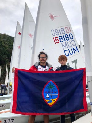 Eric Thomson, 15, right, will compete in the Hong Kong Race Week series. He's been training with coach Made Bradley, left, a U.S. Sail certified instructor with the Marianas Yacht Club.