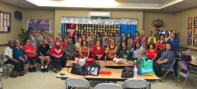 "In its mission of ""Caring for the Sick and the Elderly,"" members of the Guam Sunshine Lions Club joined in fellowship with the seniors at the Mangilao Senior Citizens Center on Feb. 13, 2019. Members brought snacks and bingo dabbers, and entertained the manamko' with a medley of traditional CHamoru songs."