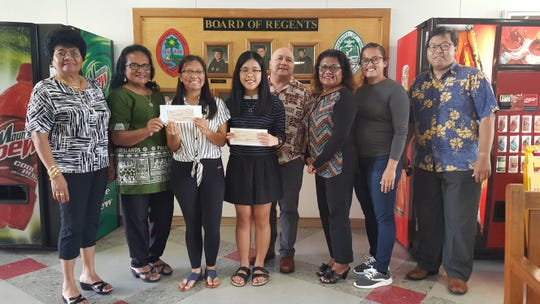 Two University of Guam students received scholarships in January from the Palau Women's Club of Guam. Freshman biology major Mary Heather B. Jingco and freshman pre-nursing major Megan P. Babauta each received $1,000. The students were selected based on their grade point average, community service involvement, and personal career objectives. Pictured from left: Margie Bautista, treasurer; Esther Espangel, vice president, both of the Palau Women's Club of Guam; Jingco; Babauta; Lawrence F. Camacho, dean of Enrollment Management and Student Success at UOG; Laurie Pangelinan, president of the Palau Women's Club; Alicia Borja, vice chairman for the Scholarship Program with the Palau Women's Club of Guam and a past recipient of the scholarship; and Mark A. Duarte, director for Financial Aid at UOG.