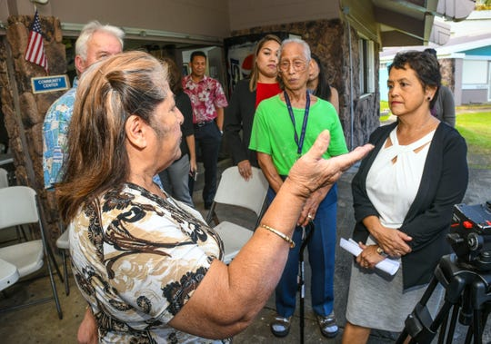 Dorothy Millar, 74, voices her opinion and concern to Gov. Lou Leon Guerrero, right, during her visit to Guam Trankilidat on Thursday, Feb. 14, 2019.