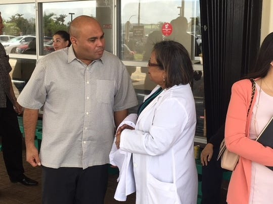 Lt. Gov. Joshua Tenorio, left, talks to Guam Memorial Hospital acting Administrator Lillian Perez-Posadas before a tour of the Tamuning hospital facility Feb. 11, 2019.
