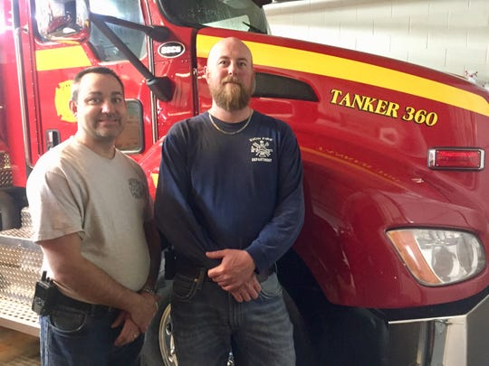 Melvin Fulkerson, left, and Chad Patterson pose in front of Zion Volunteer Fire Department's new tanker truck.