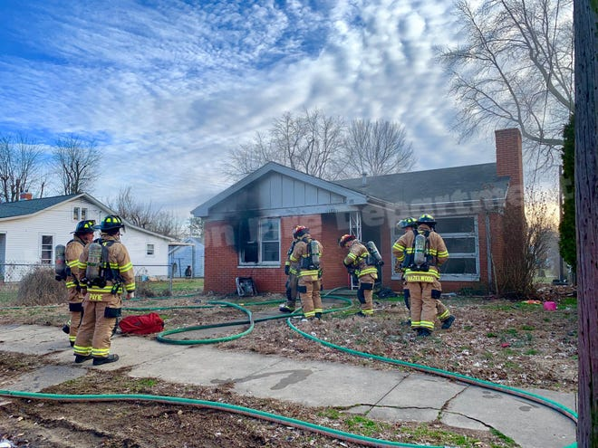 In this photo by the Henderson Fire Department, HFD personnel respond to a blaze on Clay Street Wednesday that is  believed to have been intentional.