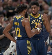 Tyreke Evans of the Indiana Pacers chats with teammate Thaddeus Young, Bankers Life Fieldhouse, Indianapolis, Wednesday, Feb. 13, 2019. Milwaukee won 106-97.