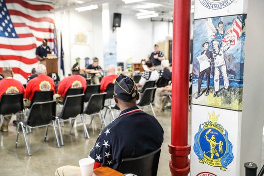 Inmate and  American Legion Post #608 Judge Advocate, Ricky Harlan watches a meeting of Legion members from the rear of the room at American Legion Post George D. Vickery Post #608, located inside of the Pendleton Correctional Facility in Ind., on Wednesday, Feb. 6, 2019.