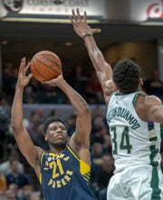 Thaddeus Young of the Indiana Pacers puts up a shot as he is defended by Giannis Antetokounmpo of the Milwaukee Bucks who scored a triple double in the game at Bankers Life Fieldhouse, Indianapolis, Wednesday, Feb. 13, 2019. Milwaukee won 106-97.