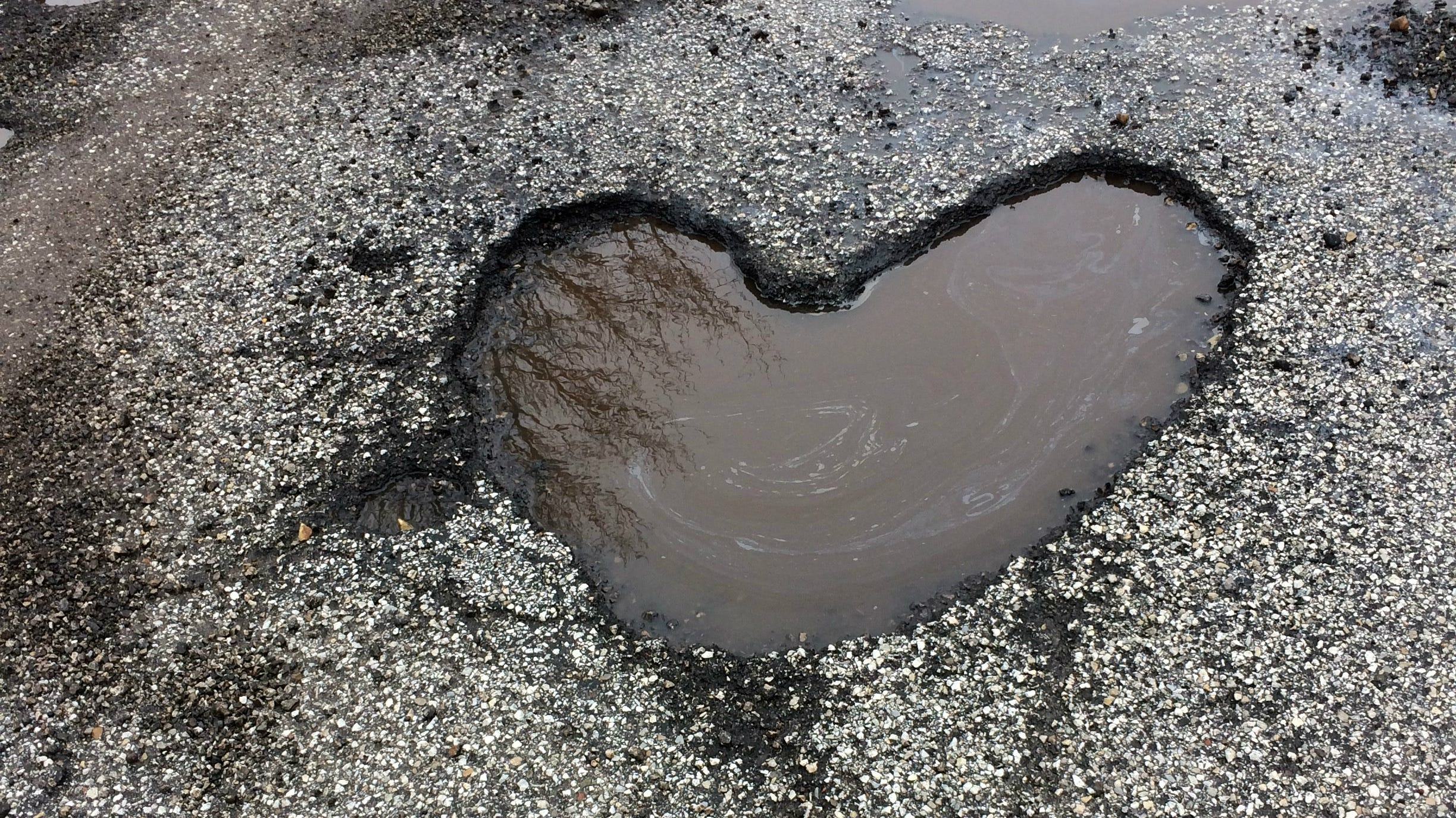 Man discovers perfect heart-shaped pothole for Valentine's Day