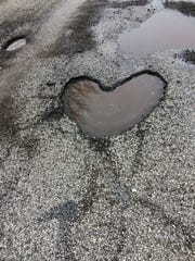 Phil Williams saw this heart-shaped pothole on his daily walk.