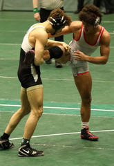 Elijah Mahan, right, drives his wrestling coach crazy with this move. It should be easy for an opponent to flip him over with that upraised leg... but it's not. His legs are too strong, thanks to his dance moves.