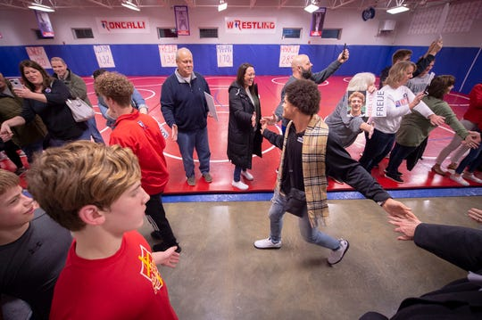 Elijah Mahan, competing at the 170-pound weight class, is greeted by supporters as he enters the school's wrestling room. He is among this year's favorites for a title. Five Roncalli High School wrestlers received a send-off from their teammates, friends and family Wednesday, Feb. 13, 2019 as they prepare to compete in the 2019 IHSAA Wrestling State Finals this weekend at Bankers Life Fieldhouse.
