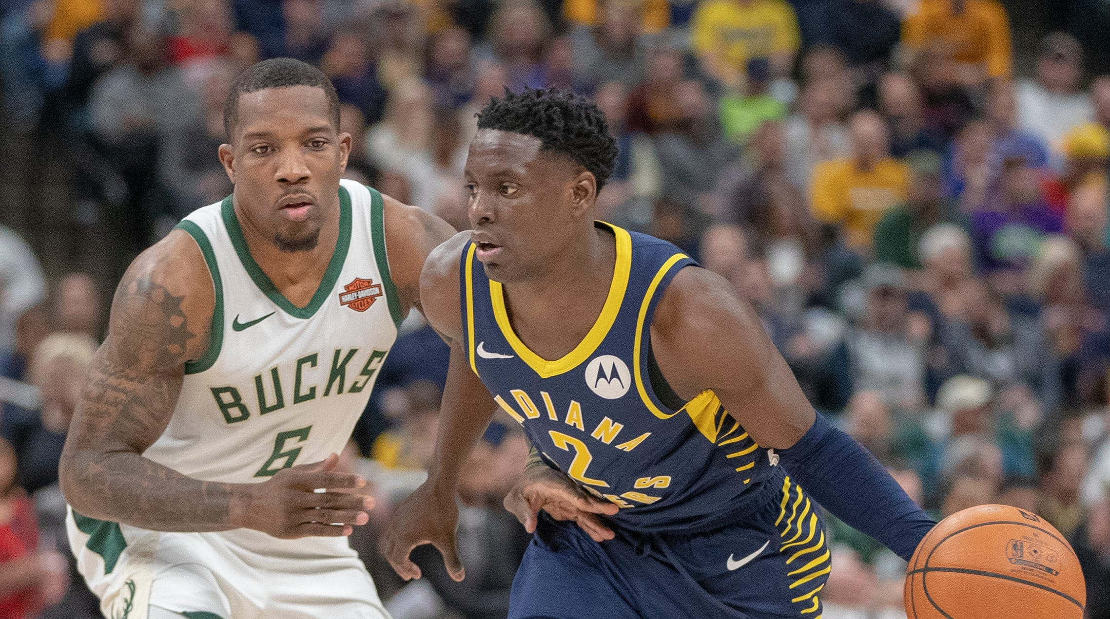 Darren Collison of the Indiana Pacers works around Eric Bledsoe of the Milwaukee Bucks, Bankers Life Fieldhouse, Indianapolis, Wednesday, Feb. 13, 2019. Milwaukee won 106-97.