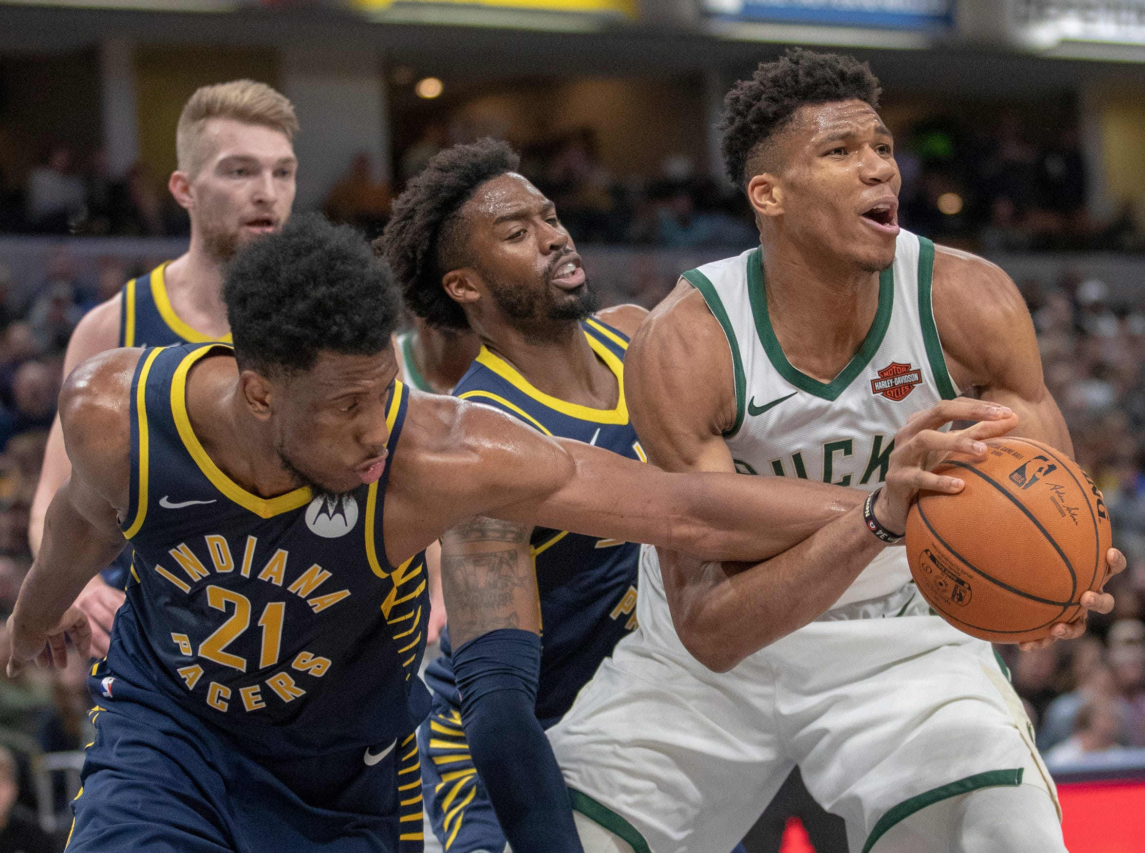 Thaddeus Young of the Indiana Pacers defends Giannis Antetokounmpo of the Milwaukee Bucks during first half action, Bankers Life Fieldhouse, Wednesday, Feb. 13, 2019.