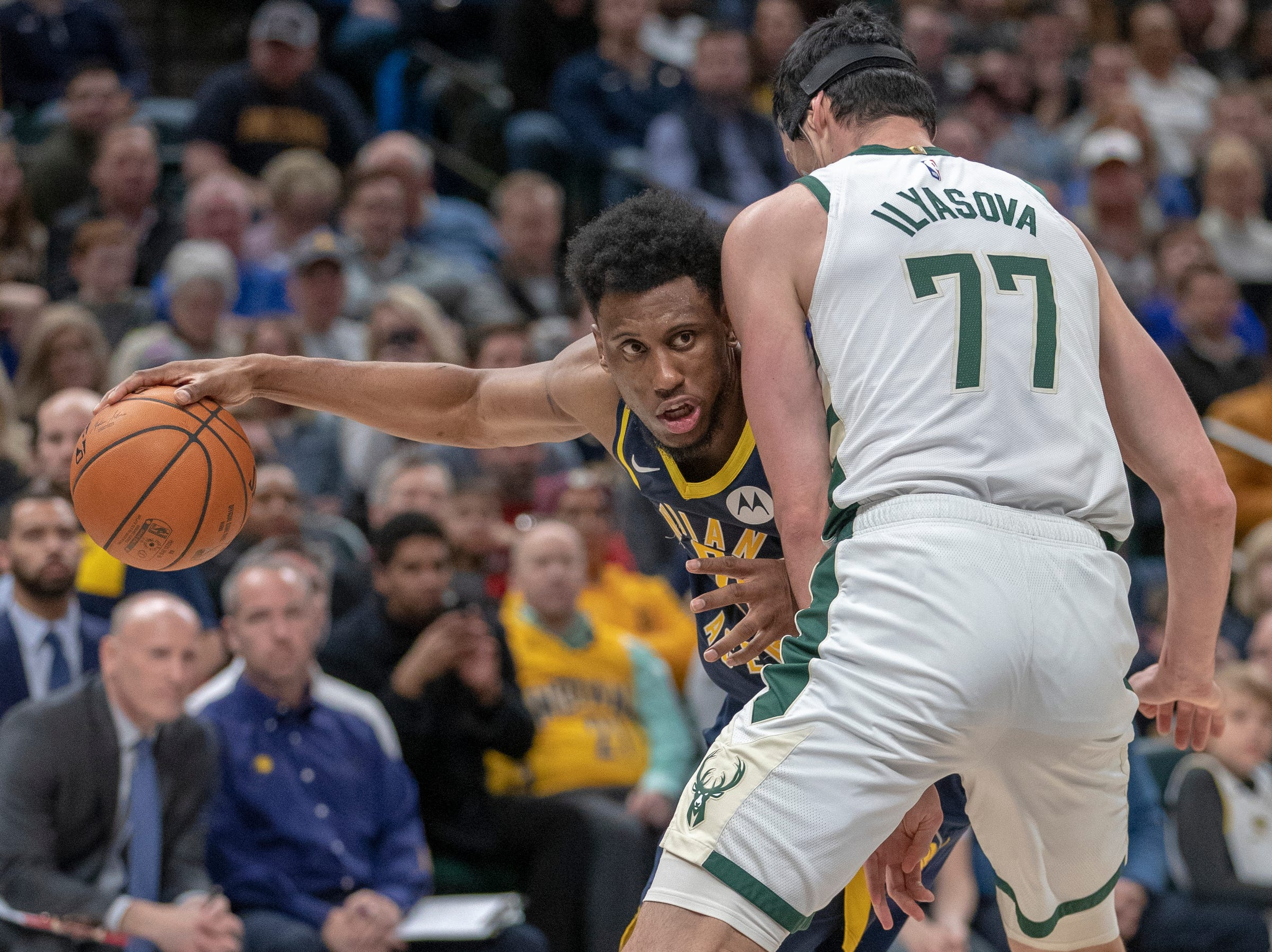 Thaddeus Young of the Indiana Pacers considers his options as he is defended by Ersan Ilyasova of the Milwaukee Bucks, Bankers Life Fieldhouse, Indianapolis, Wednesday, Feb. 13, 2019. Milwaukee won 106-97.