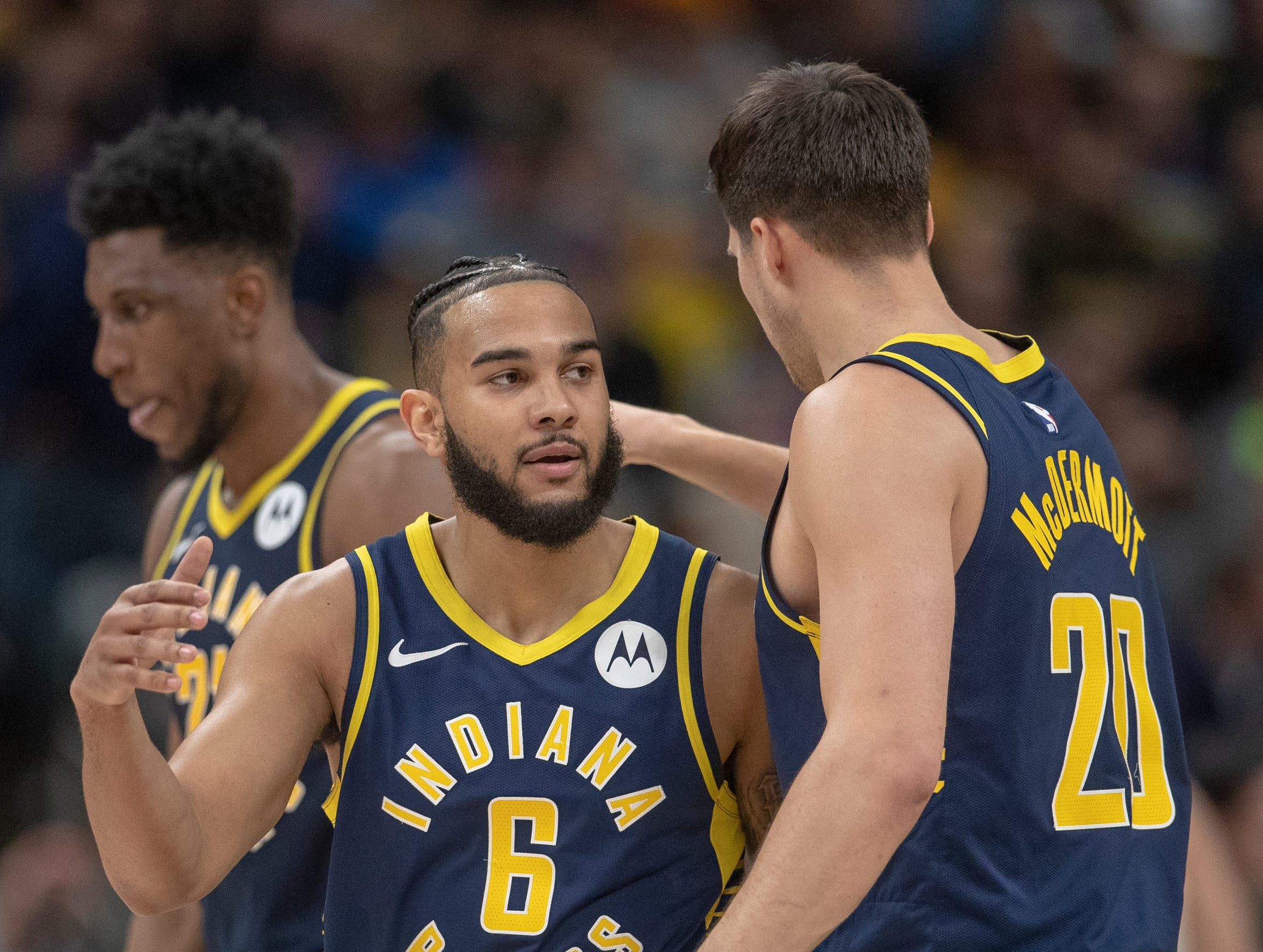 Cory Joseph of the Indiana Pacers (left), and Doug McDermott of the Indiana Pacers embrace after a Pacers basket, Bankers Life Fieldhouse, Wednesday, Feb. 13, 2019. Milwaukee won 106-97.