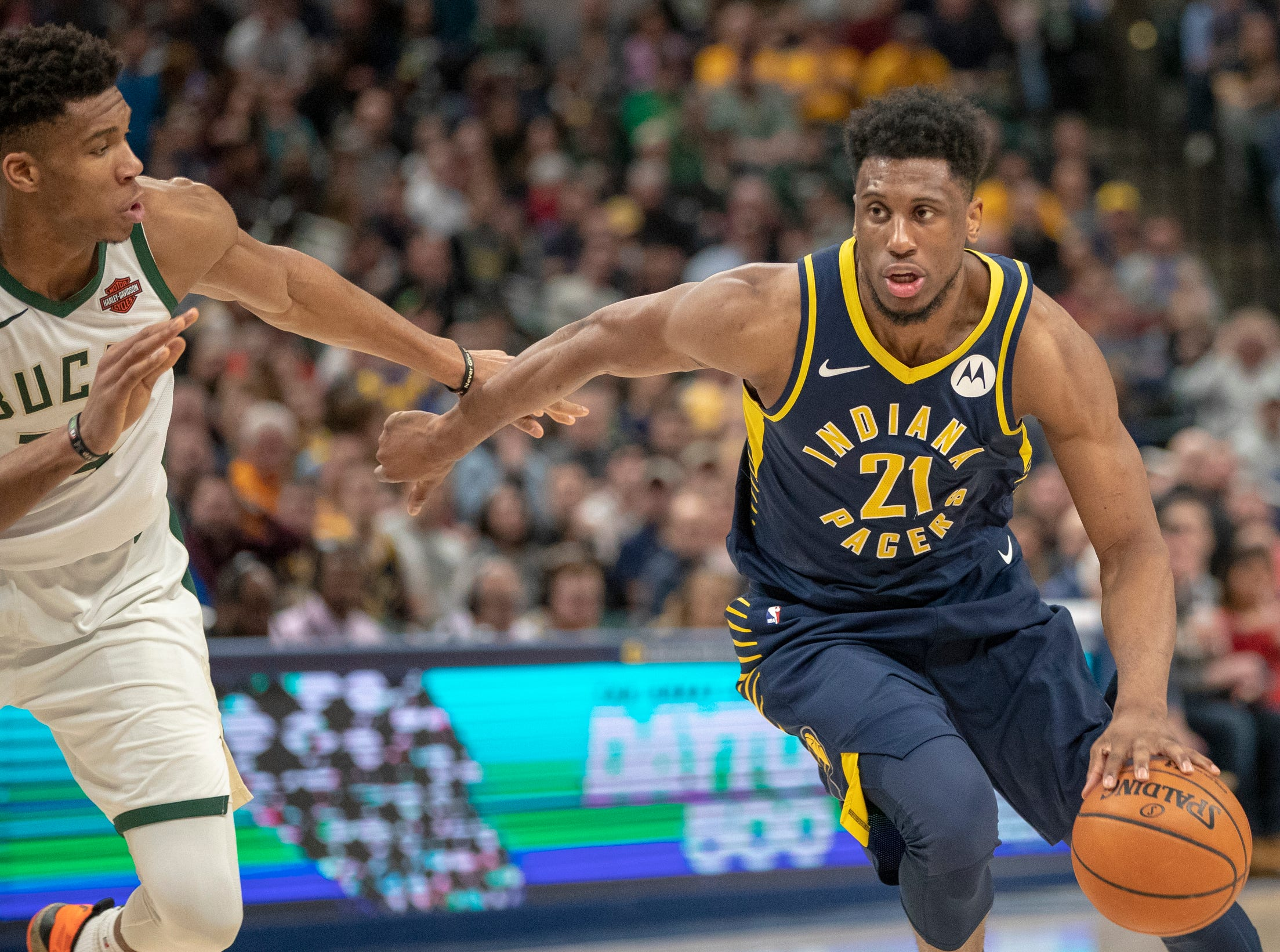 Thaddeus Young of the Indiana Pacers looks to drive on Giannis Antetokounmpo of the Milwaukee Bucks, Bankers Life Fieldhouse, Indianapolis, Wednesday, Feb. 13, 2019. Milwaukee won 106-97.