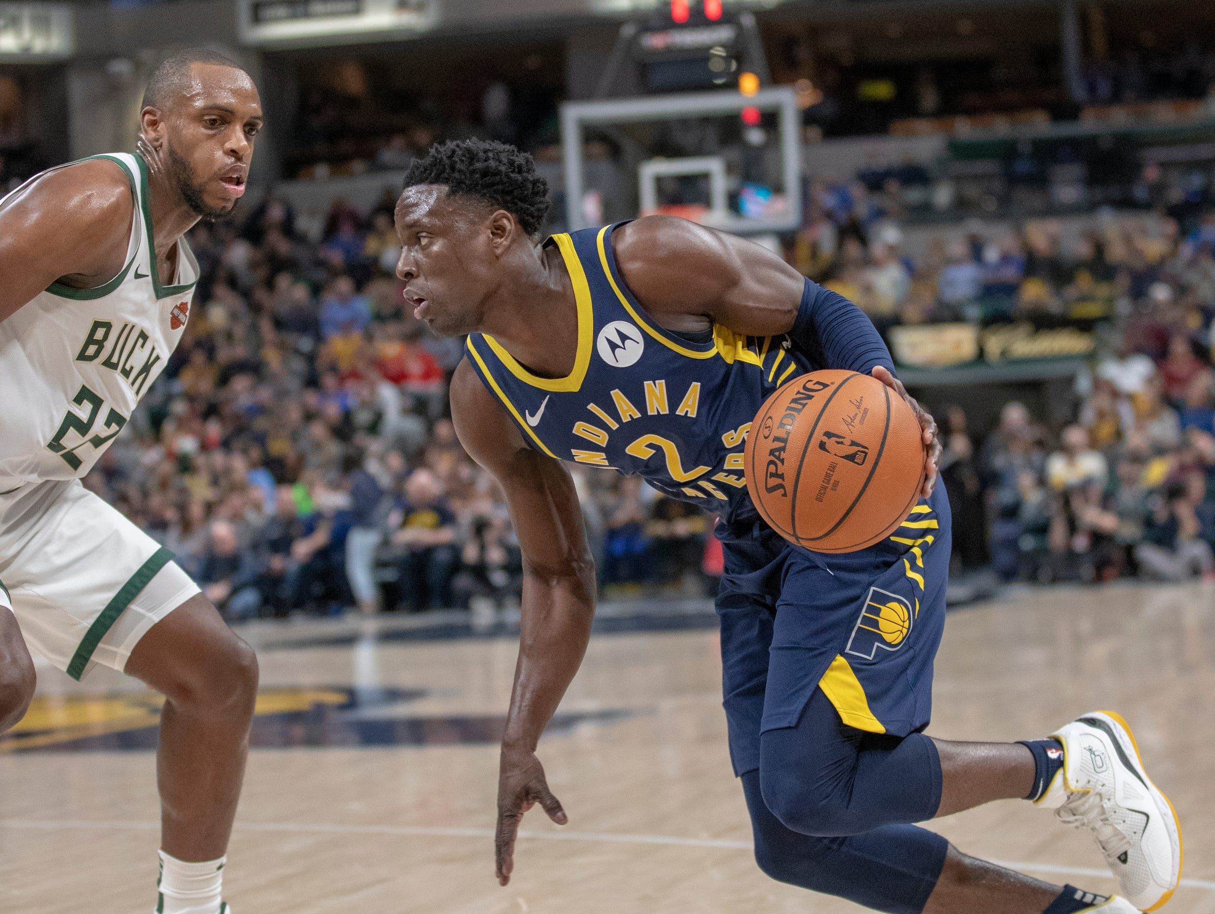Darren Collison of the Indiana Pacers drives on Khris Middleton of the Milwaukee Bucks, Bankers Life Fieldhouse, Indianapolis, Wednesday, Feb. 13, 2019. Milwaukee won 106-97.