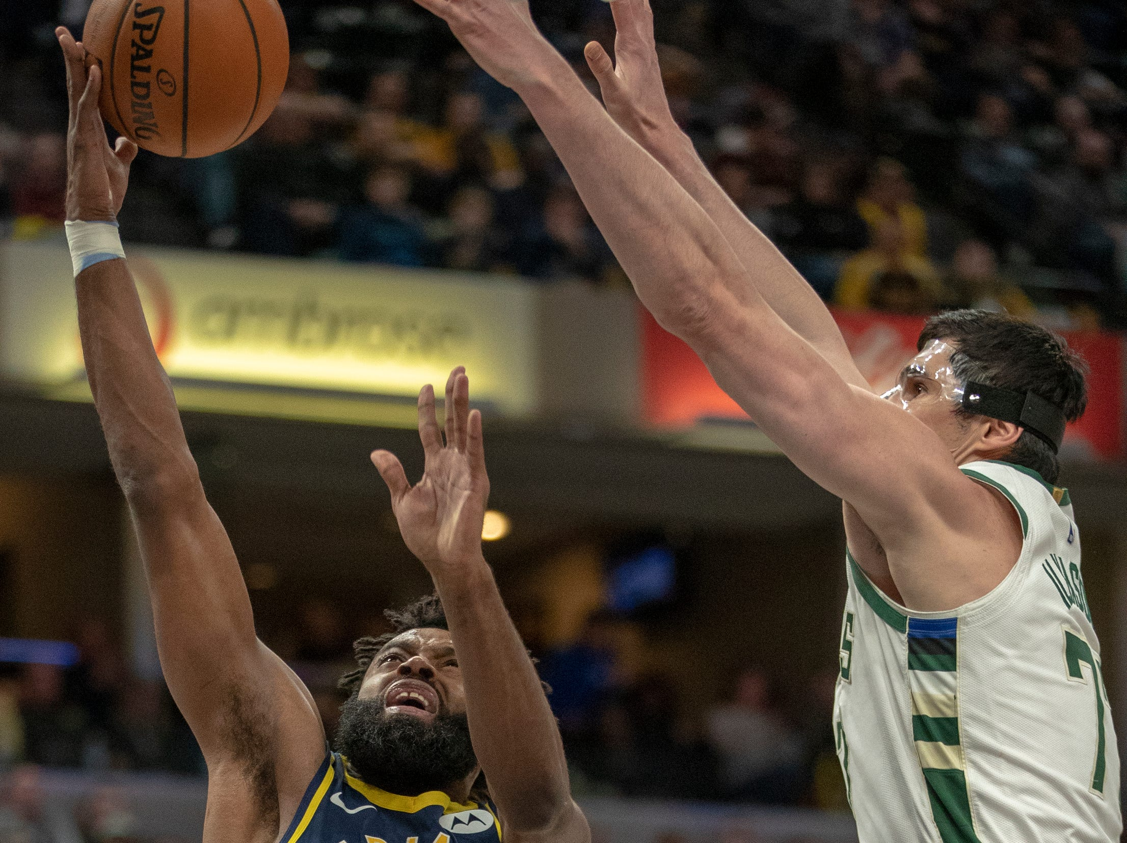 Tyreke Evans of the Indiana Pacers puts up a shot as he is defended by Ersan Ilyasova of the Milwaukee Bucks, Bankers Life Fieldhouse, Indianapolis, Wednesday, Feb. 13, 2019. Milwaukee won 106-97.