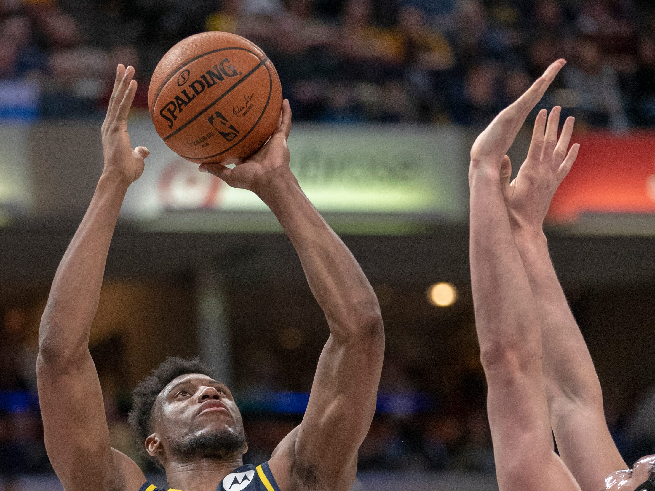 Thaddeus Young of the Indiana Pacers shoots against Ersan Ilyasova of the Milwaukee Bucks, Bankers Life Fieldhouse, Indianapolis, Wednesday, Feb. 13, 2019. Milwaukee won 106-97.