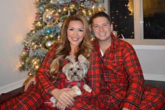 Rachel Bogle and her boyfriend pose with her dog.
