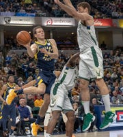 Bojan Bogdanovic of the Indiana Pacers flicks a pass to a teammate under the basket during action against Milwaukee, Bankers Life Fieldhouse, Indianapolis, Wednesday, Feb. 13, 2019. Milwaukee won 106-97.