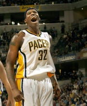 Indiana's Al Harrington reacted to a dunk in a 2006 game against the Orlando Magic. The Pacers won. Harrington says he never used marijuana as a player.