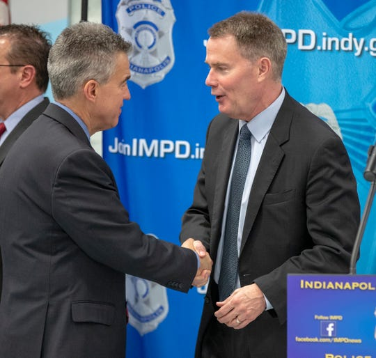 Josh Minkler, U.S. Attorney, (left), shakes the hand of former U.S. Attorney and current mayor Joe Hogsett, following an announcement about a multi-agency operation that resulted in 25 people charged, plus removal of guns and narcotics from Indianapolis, Thursday, Feb. 14, 2019. The operation, dubbed Garage Band, resulted in the seizing of methamphetamine, heroin, and cocaine, plus 40 firearms of varying types.