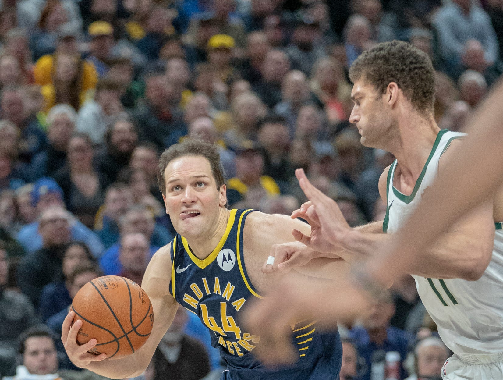 Bojan Bogdanovic of the Indiana Pacers heads for the basket against Brook Lopez of the Milwaukee Bucks, Bankers Life Fieldhouse, Indianapolis, Wednesday, Feb. 13, 2019. Milwaukee won 106-97.