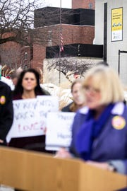 Cathy Glasson, SEIU Local 199 president, speaks at a press conference with members of the UIHC union during a Valentine's Day protest over bargaining with the hospital CEO and Regents, Thursday, Feb. 14, 2019 at the University of Iowa Hospitals and Clinics in Iowa City, Iowa.