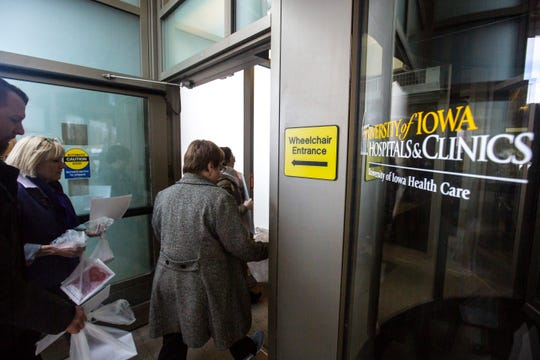 Members of the UIHC union walk into the building after holding a Valentine's Day protest over bargaining with the hospital CEO and Regents, Thursday, Feb. 14, 2019 at the University of Iowa Hospitals and Clinics in Iowa City, Iowa.