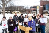 SEIU Local 199 president Cathy Glasson spoke at a Valentine's Day press conference with a message to the UIHC CEO during contract negotiations.