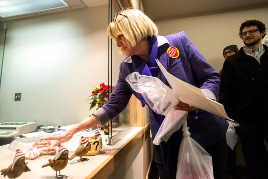 Cathy Glasson, SEIU Local 199 president, delivers cookies and cards to the administrative offices after speaking at a Valentine's Day protest over bargaining with the hospital CEO and Regents, Thursday, Feb. 14, 2019 at the University of Iowa Hospitals and Clinics in Iowa City, Iowa.