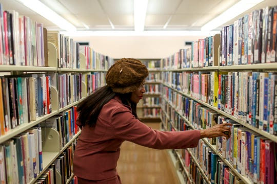 Madison County Commissioner Katie Brantley (District 5) looks through shelves of books at Jackson-Madison County Library in Jackson, Tenn., on Wednesday, Feb. 13, 2019. Brantley recalled how the library used to be segregated, how black people were not allowed access, and how entering it for the first time was a moment of triumph and hope she will never forget.