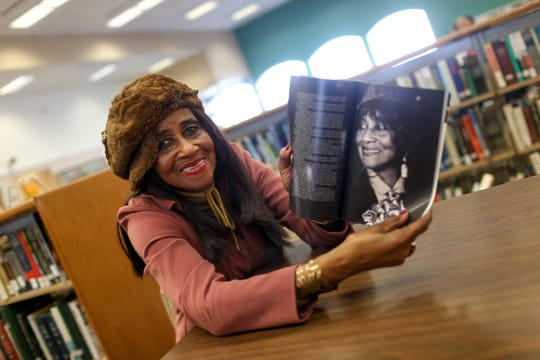 Madison County Commissioner Katie Brantley (District 5) opens up a publication displaying a portrait of her on an inside page at Jackson-Madison County Library in Jackson, Tenn., on Wednesday, Feb. 13, 2019.