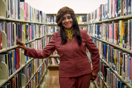 Madison County Commissioner Katie Brantley (District 5) poses for a portrait amongst rows of books at Jackson-Madison County Library in Jackson, Tenn., on Wednesday, Feb. 13, 2019.