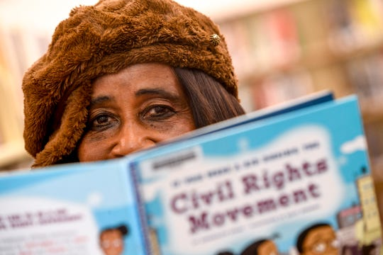 Madison County Commissioner Katie Brantley (District 5) looks up from a civil rights movement book for kids at the Jackson-Madison County Library in Jackson, Tenn., on Wednesday, Feb. 13, 2019.