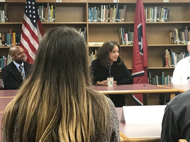 Tennessee Education Commissioner Penny Schwinn listens as students at West Carroll High School talk about life at their school.