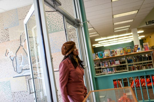 Madison County Commissioner Katie Brantley (District 5) walks through the front door at the Jackson-Madison County Library off of East Lafayette Street in Jackson, Tenn., on Wednesday, Feb. 13, 2019. Brantley recalled how the library used to be segregated, how black people were not allowed access, and how entering it for the first time was a moment of triumph and hope she will never forget.
