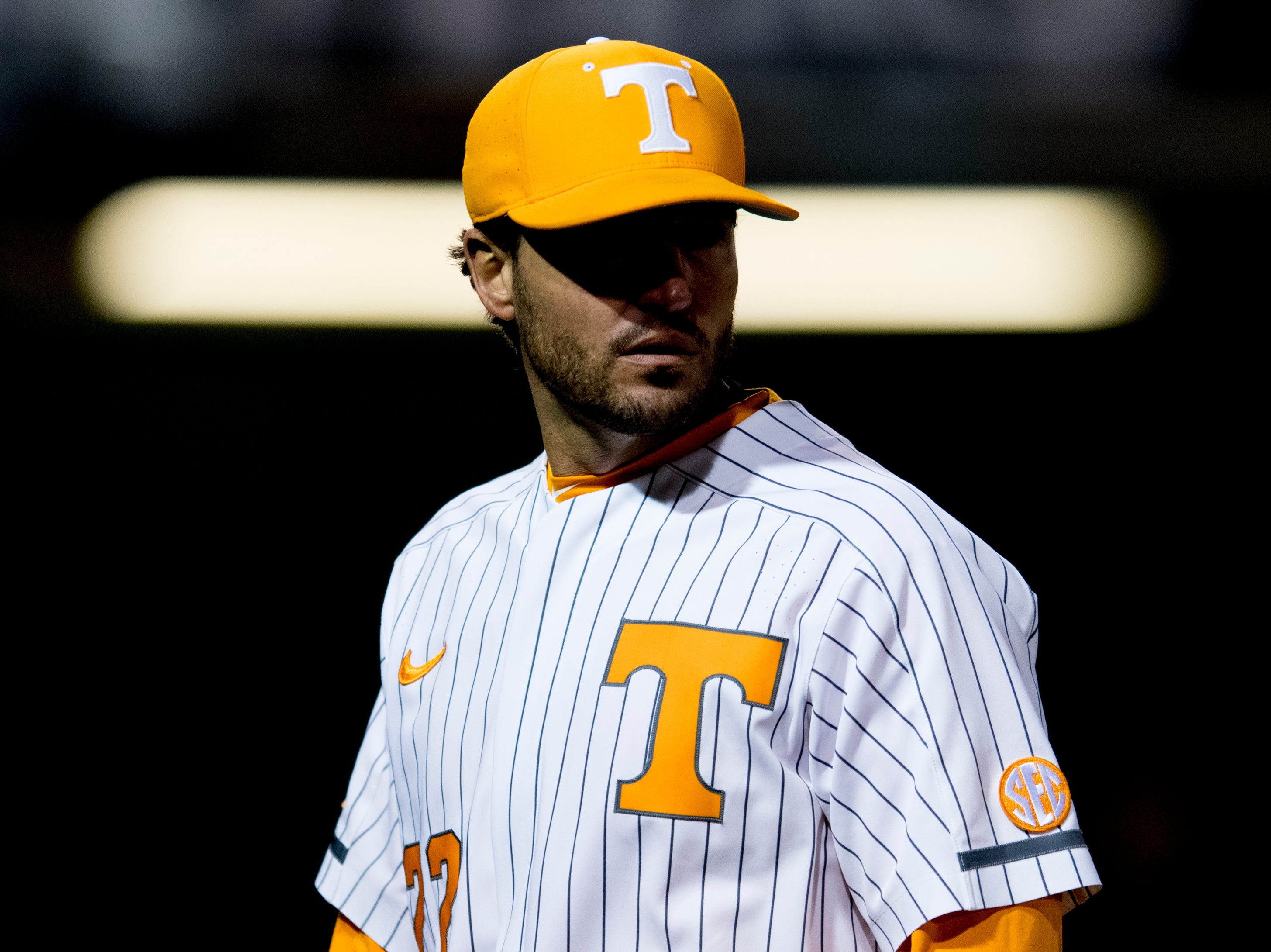 Tennessee Head Coach Tony Vitello walks on the field during a game between Tennessee and Alabama at Lindsey-Nelson Stadium in Knoxville, Tennessee on Friday, March 23, 2018.